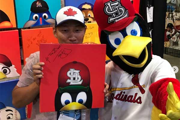 S. Preston with Fredbird, the St. Louis Cardinals mascot