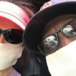 Jimmy King and Wife Donning Masks